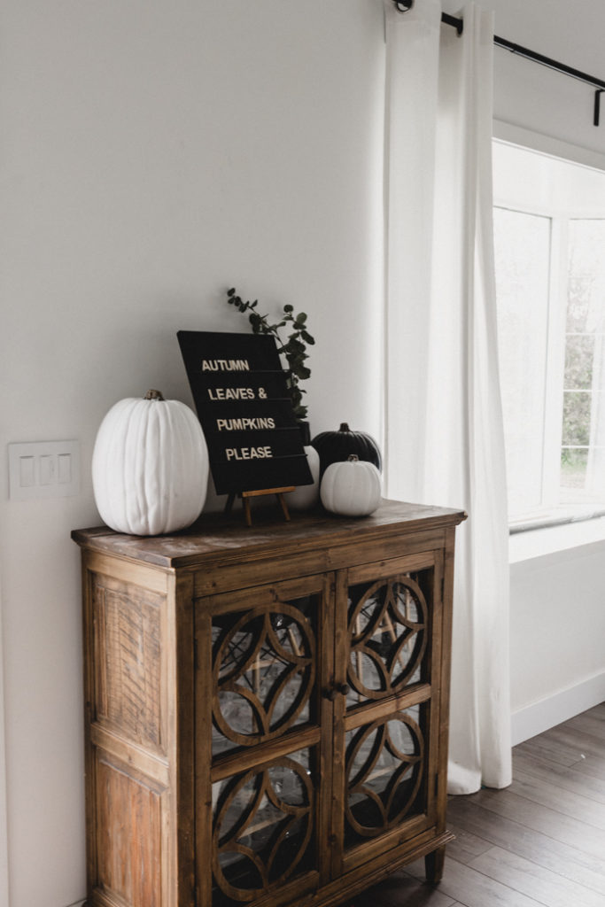 wooden sideboard decorated for fall