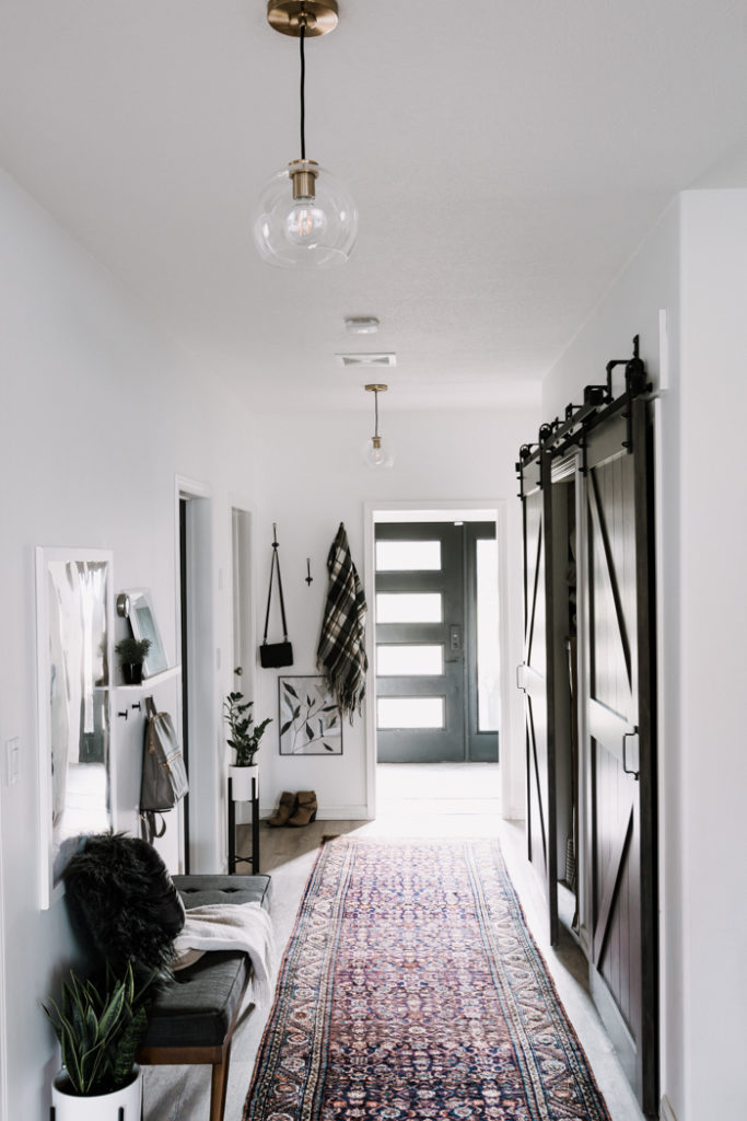 hallway with crate and barrel arren pendants