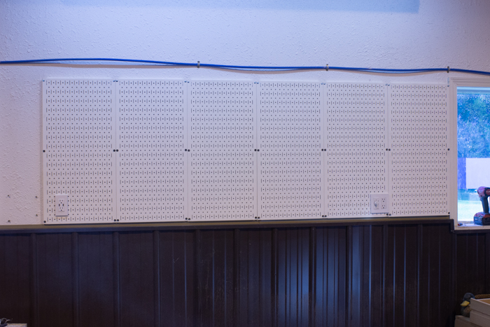wall control metal pegboard with outlets