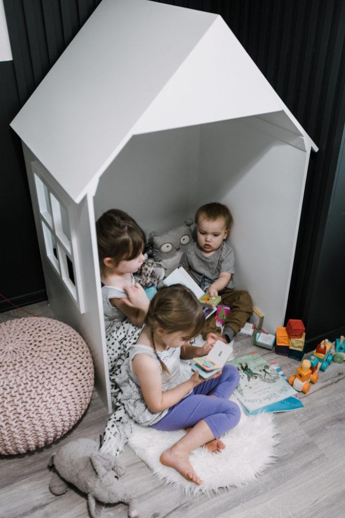 Kids in their DIY Playhouse