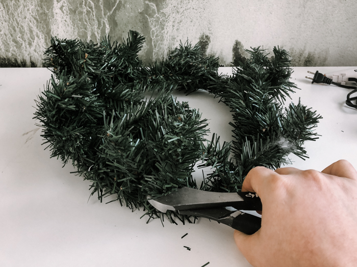 cutting apart a dollar store wreath