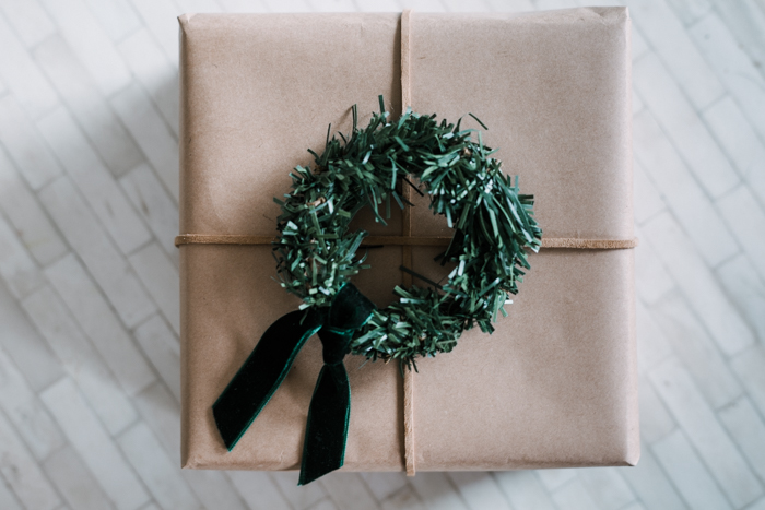 Mini wreaths on kraft paper gift