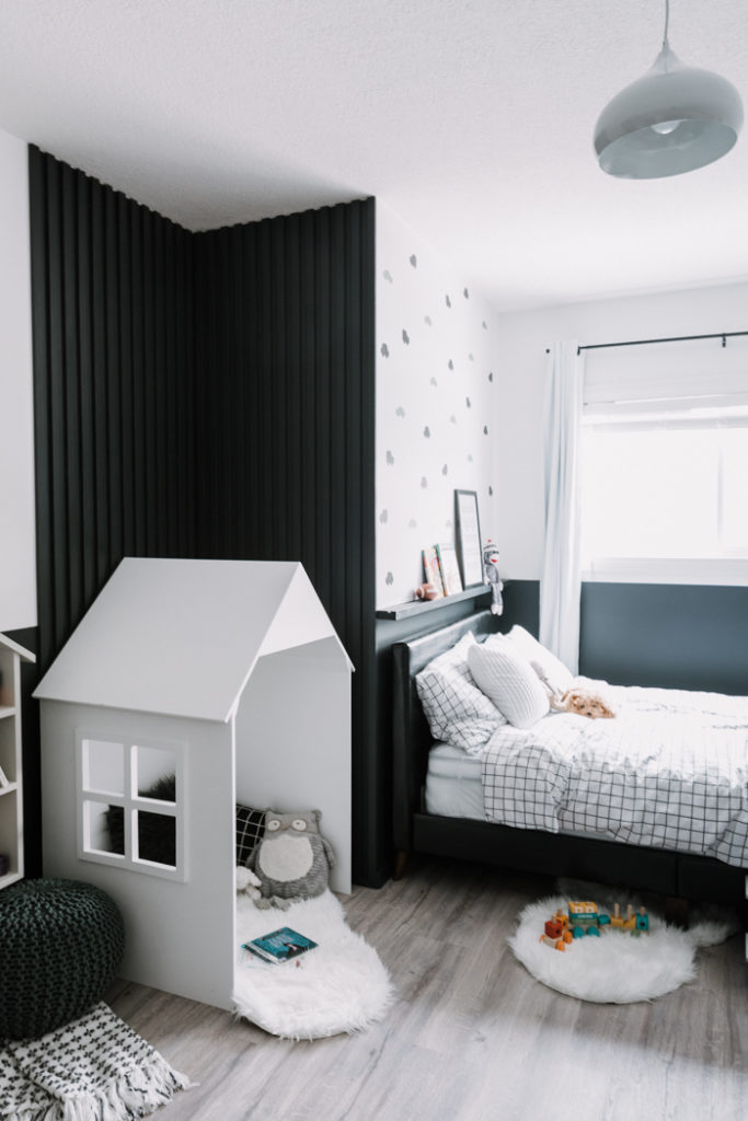accent wall and little house in modern shared bedroom