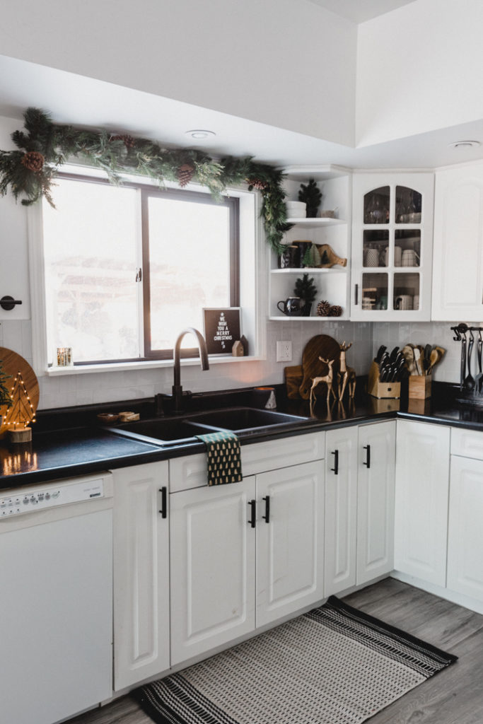 black and white kitchen with Christmas decor