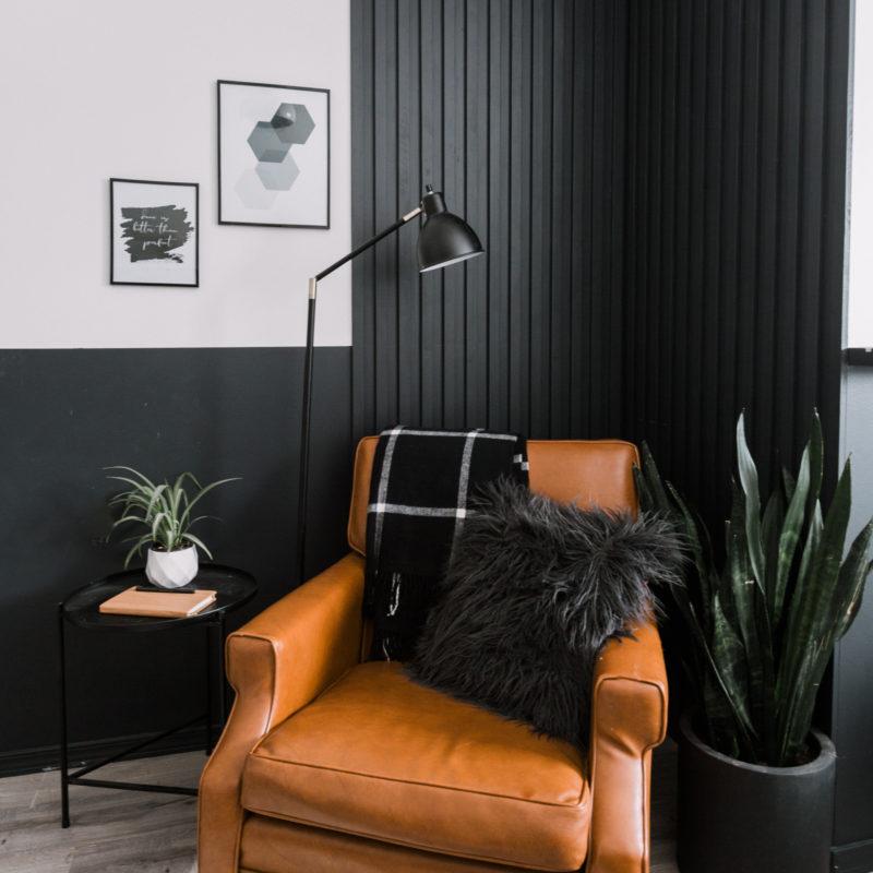 DIY wood slat wall painted black for bedroom