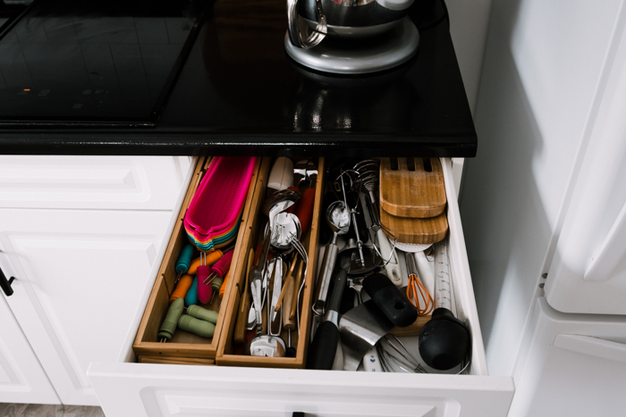 disorganized utensil drawer before makeover