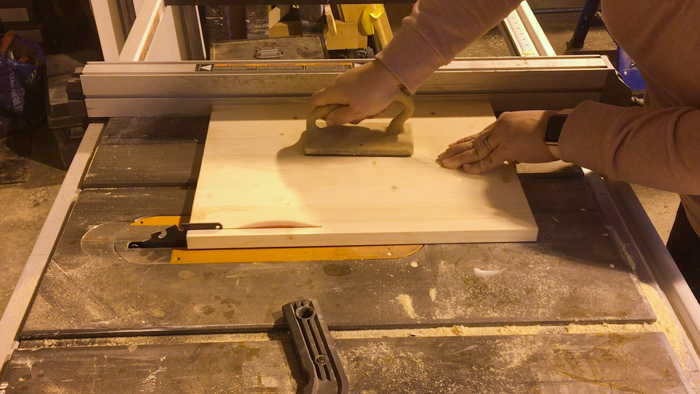 running scrap wood through table saw