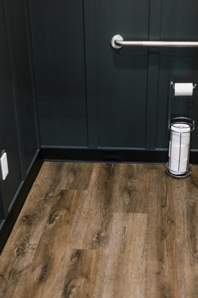 dark brown bathroom vinyl plank flooring
