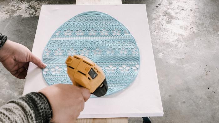 using a heat gun to flatten a stencil