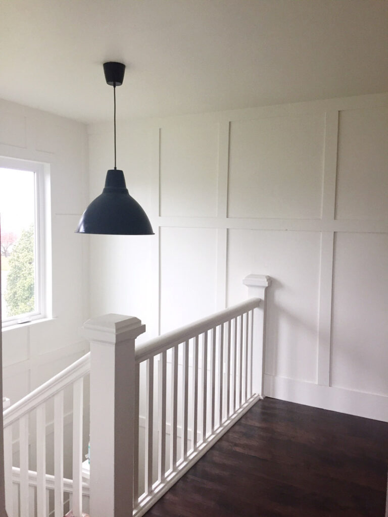 Beautiful hallway with thick board and batten walls