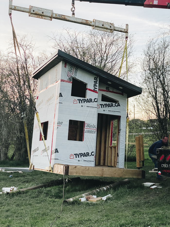 Raising the playhouse with a picker truck