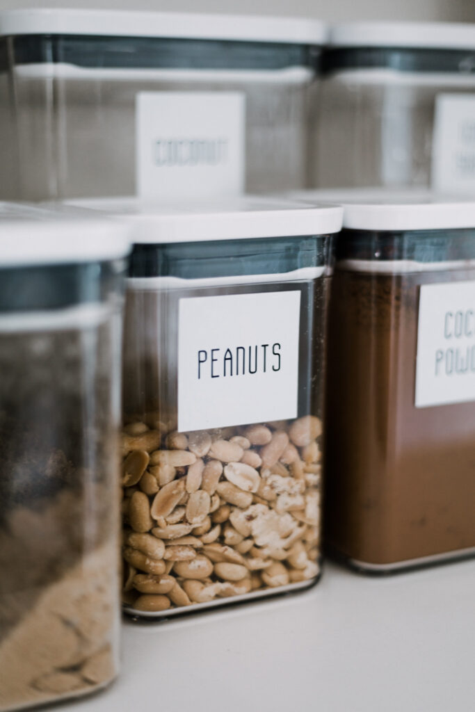 modern pantry labels with large pantry containers to reduce waste at home