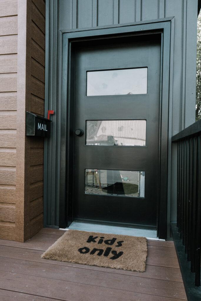 modern playhouse front door with DIY kids mat and mailbox