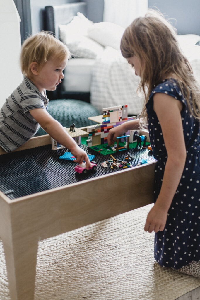 kids playing with modern lego table