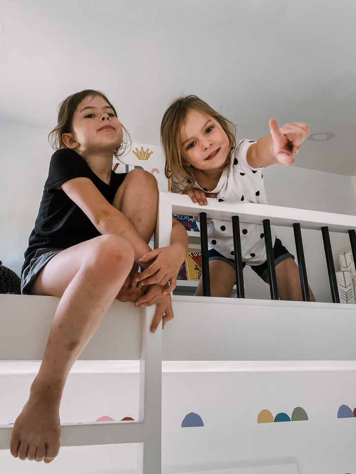 girls in the loft of their playhouse