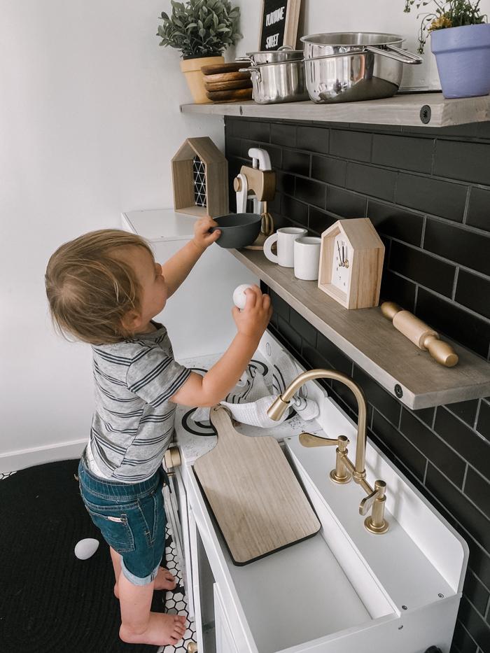 playing in modern kids kitchen
