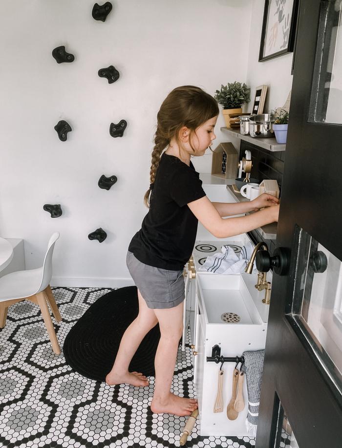 playing at kids kitchen