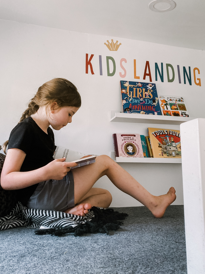 kids reading in playhouse