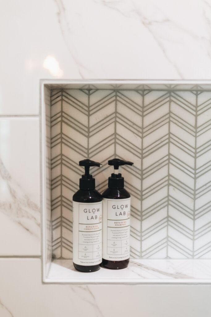 beautiful chevron tile in shower niche