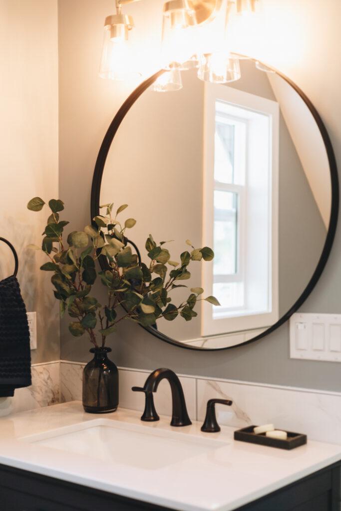 round mirror at farmhouse vanity