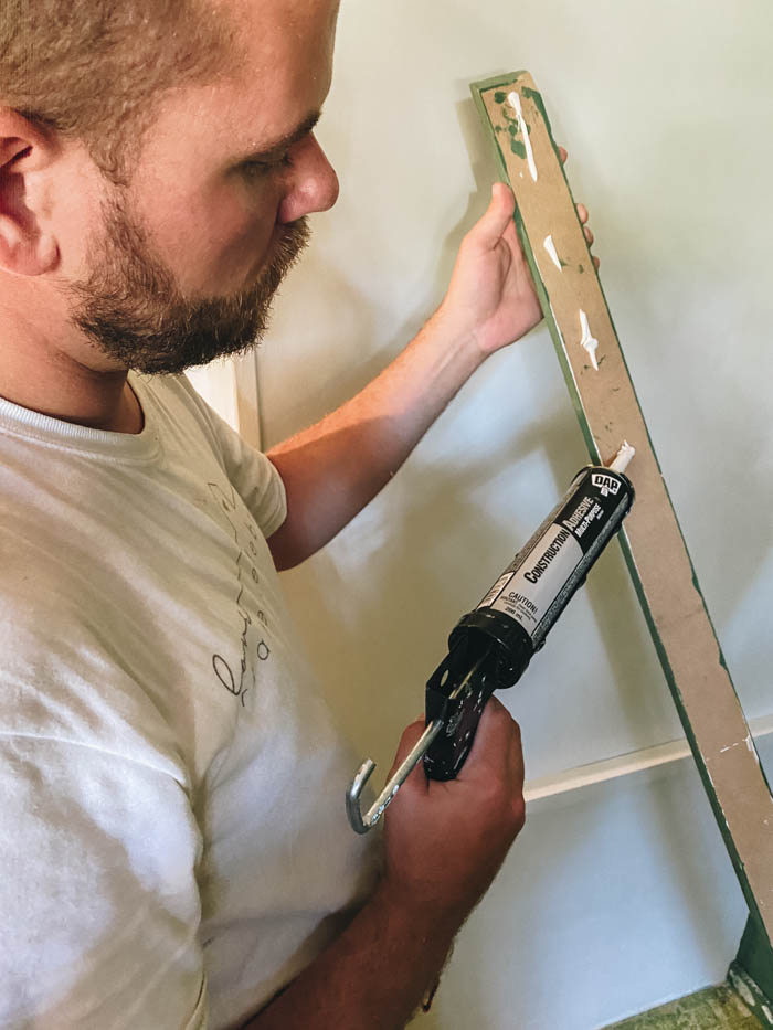 using construction adhesive to make accent wall