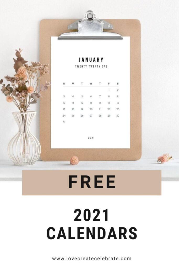 "Modern Calendar on a clipboard with text reading ""free 2021 calendar"""