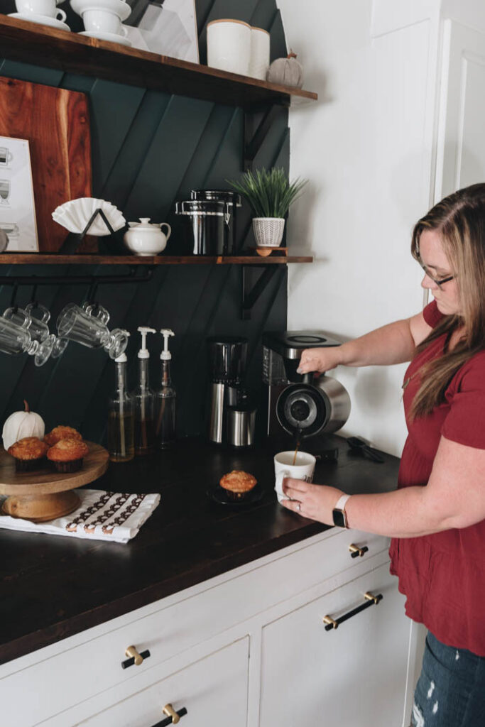 pouring coffee at simple fall coffee bar