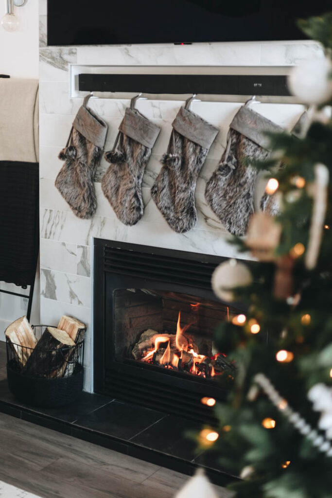modern fireplace decorated for Christmas