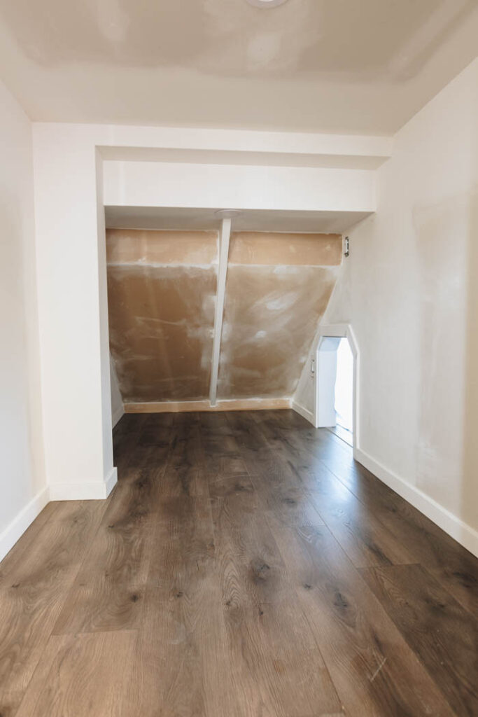 drywall and flooring under the stairs