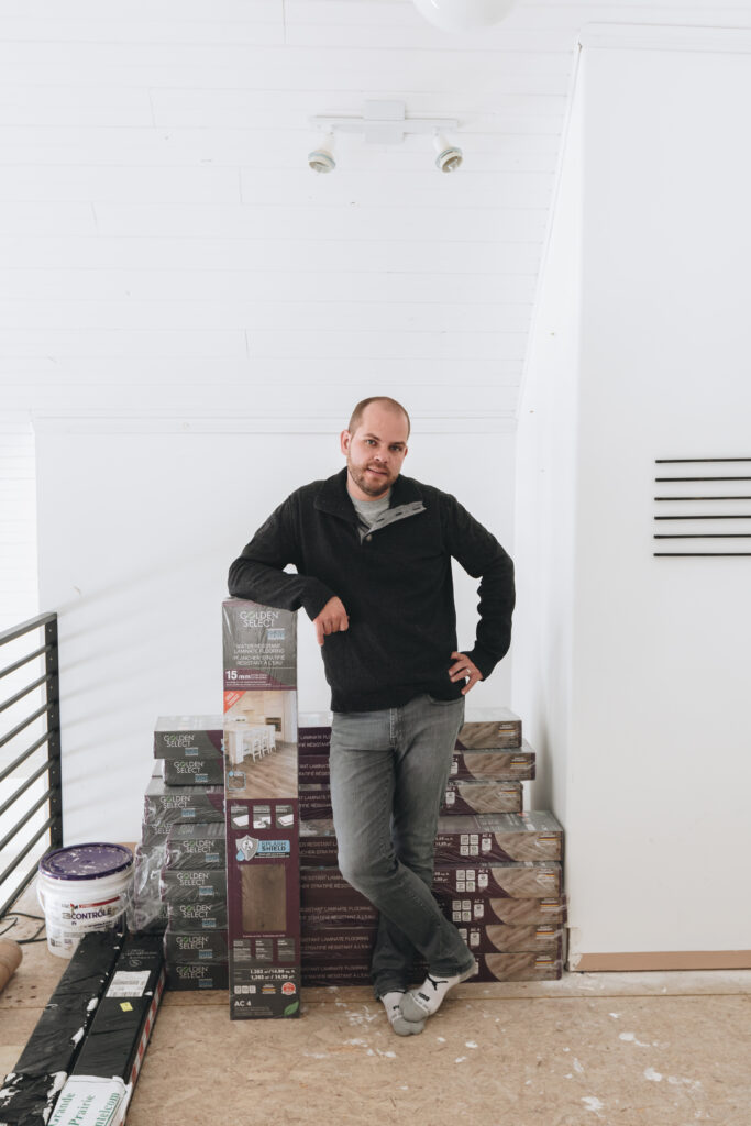 Photo of man with laminate flooring boxes