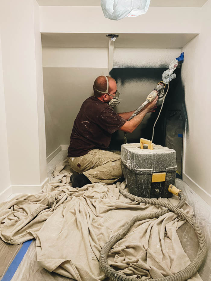 painting the space under the stairs