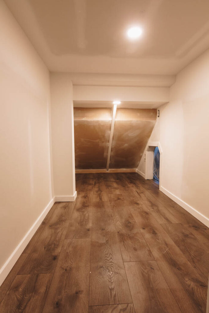 drywall and paint under the stairs