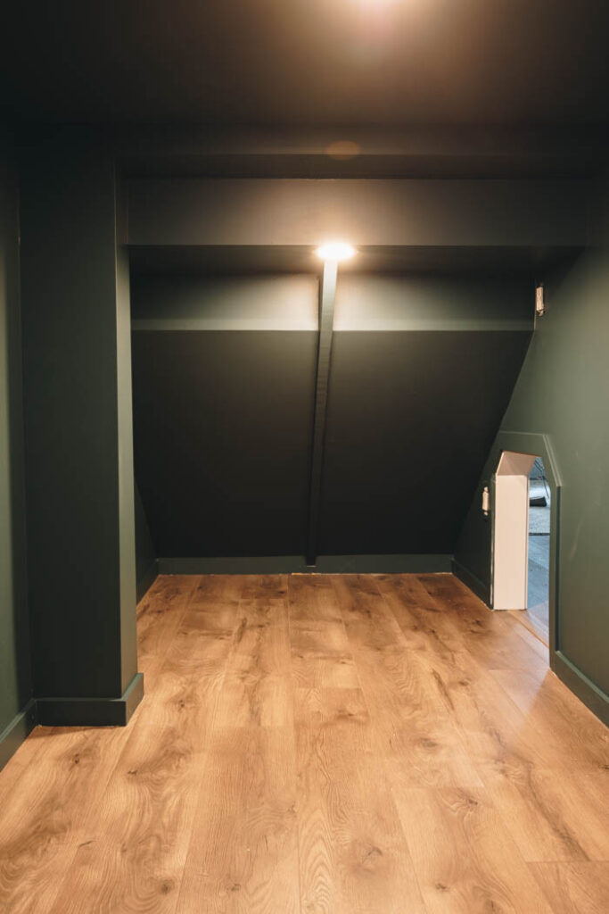 dark moody wall paint in a blue green