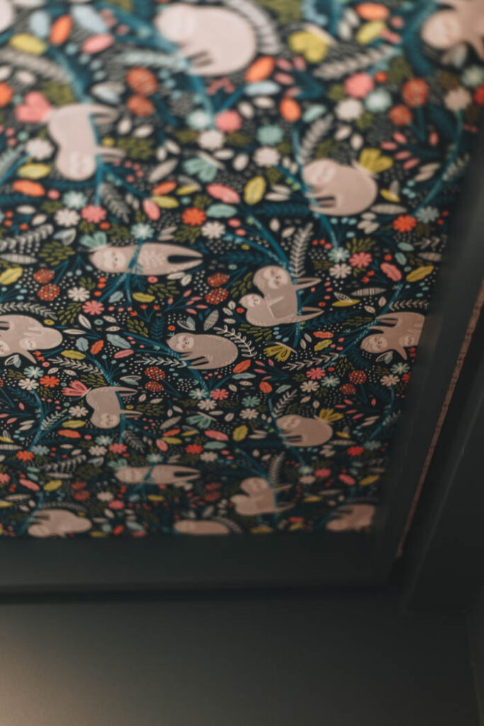 sloth wallpaper on the ceiling!