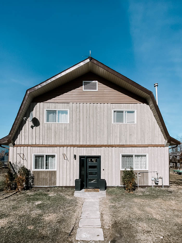 barn shaped home exterior before renovations