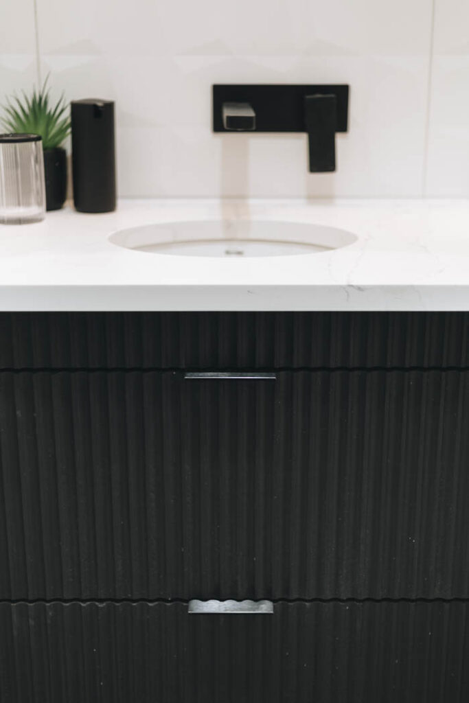 textured black bathroom vanity