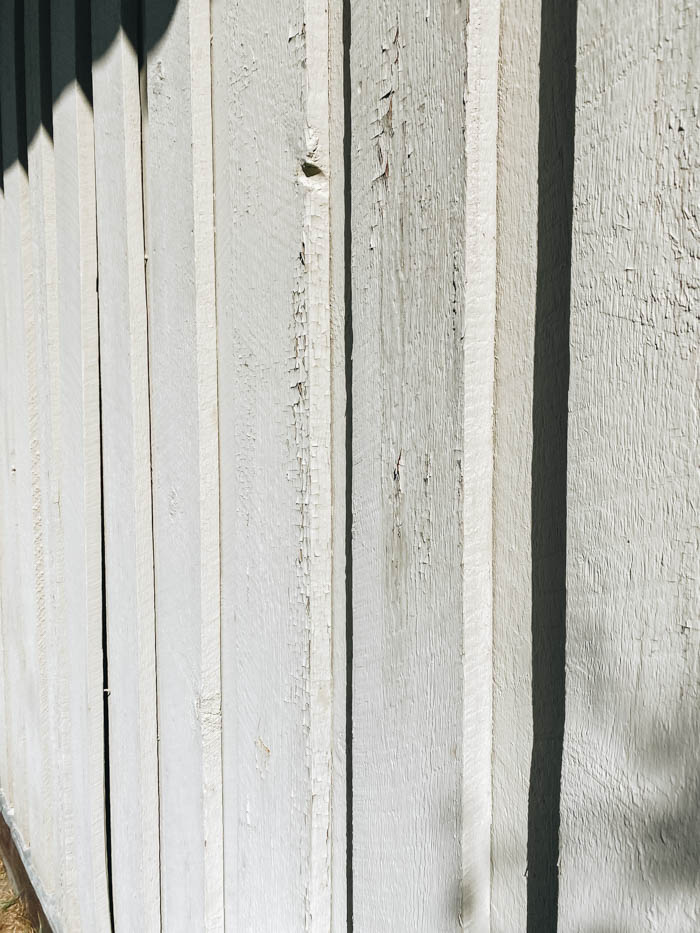 old chipping siding to show why we do exterior painting preparation