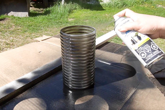 spray painting a dollar store vase outside