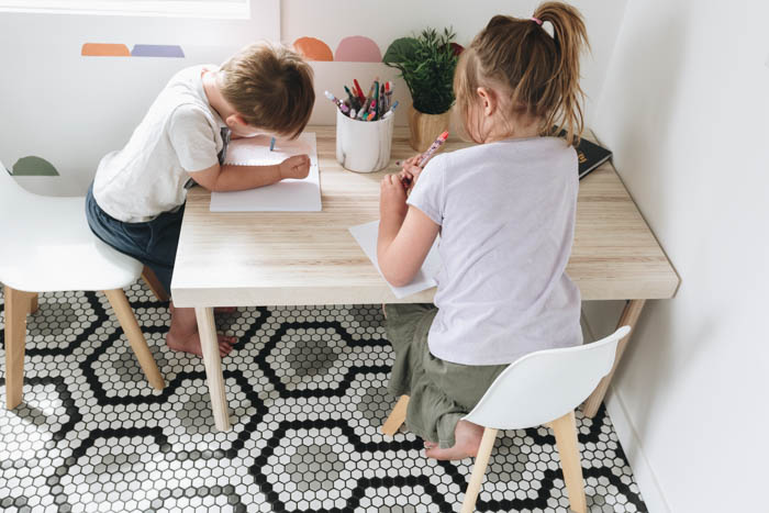 kids coloring on kid's table