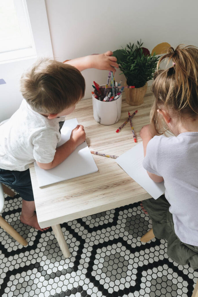 close up of kids coloring on kid's table