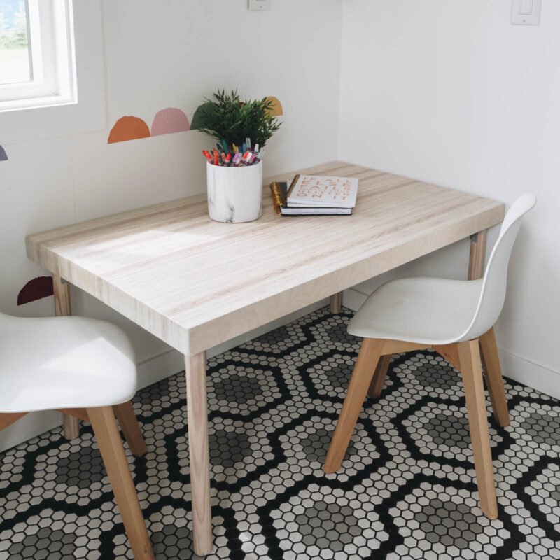 kid's table with two white kids chairs
