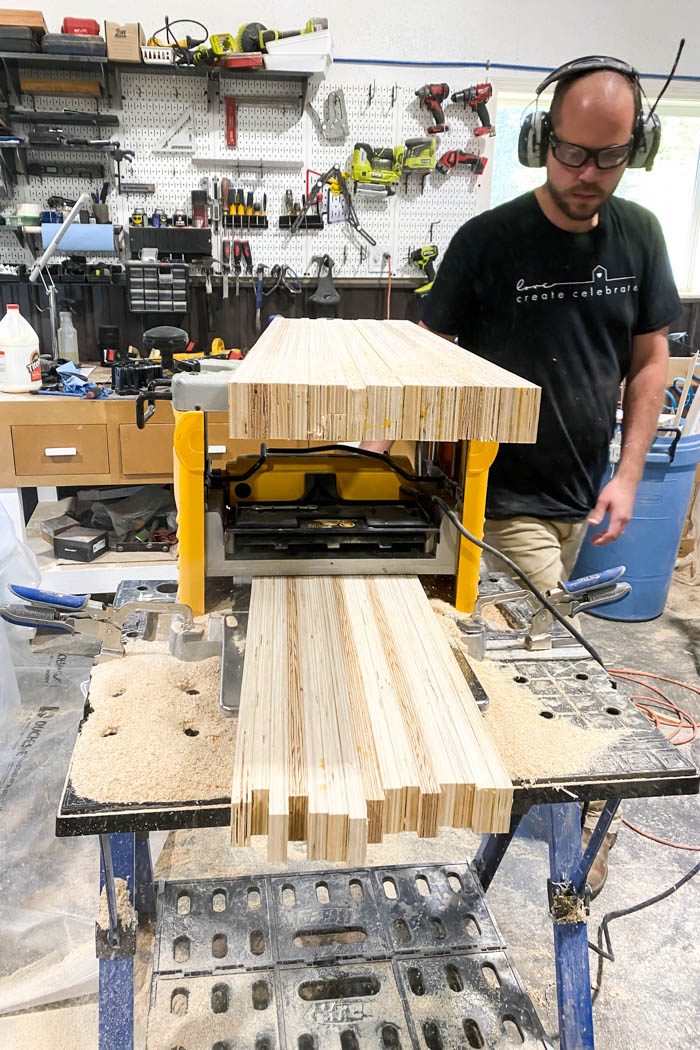kid's tabletop being put through a planer