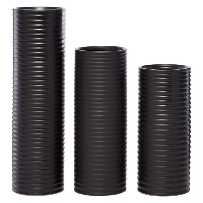 set of three black ribbed vases