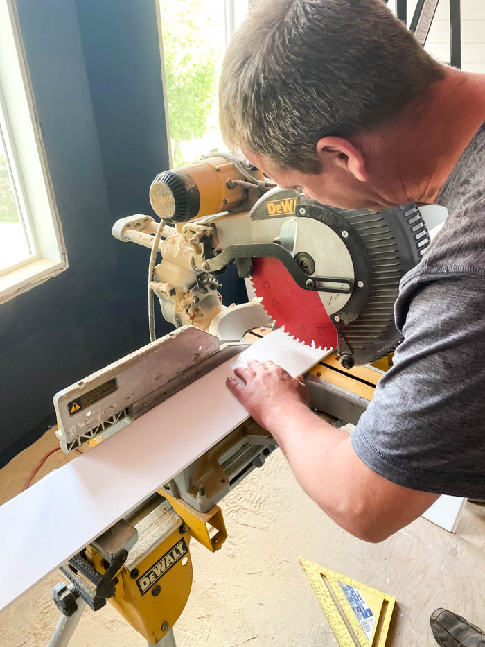 cutting shiplap board with a miter saw