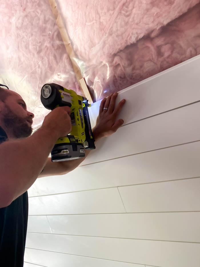 nailing shiplap to the ceiling using a brad nailer