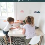 kids at a table colouring