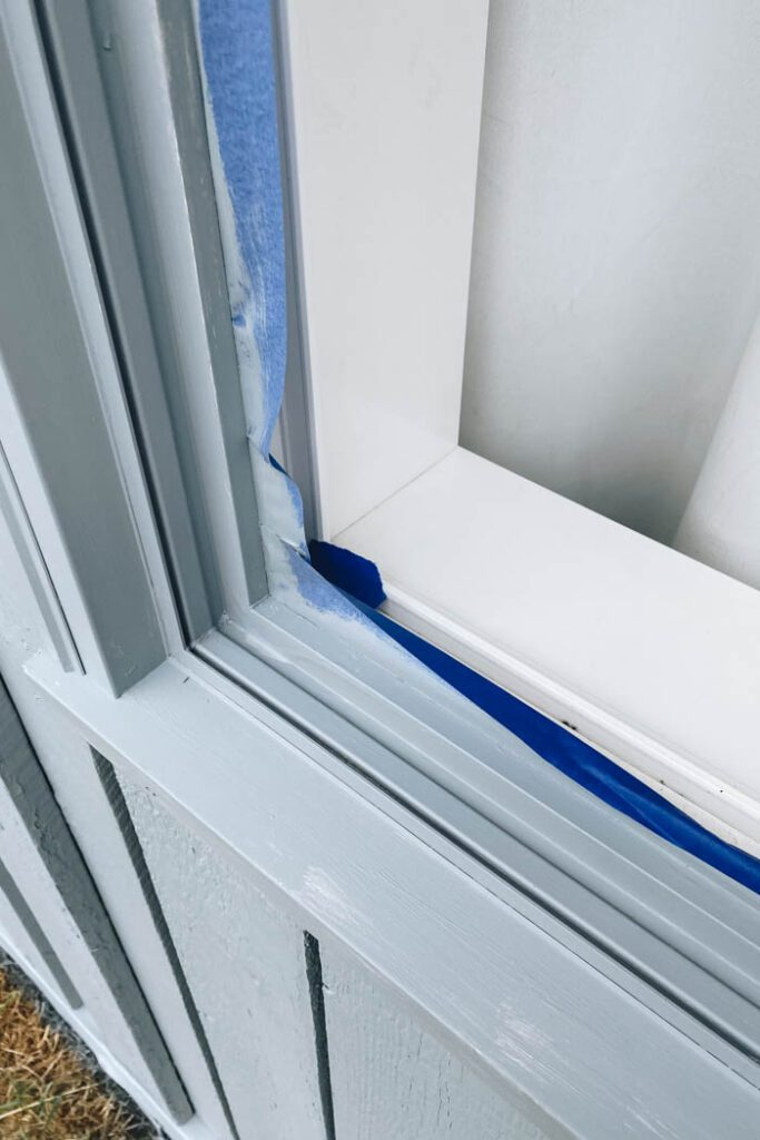 showing how to protect window tract when painting