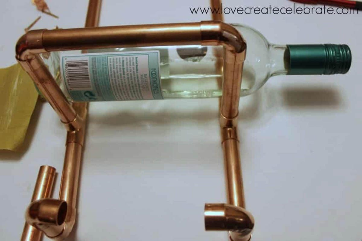 Test fitting a wine bottle for the copper wine rack