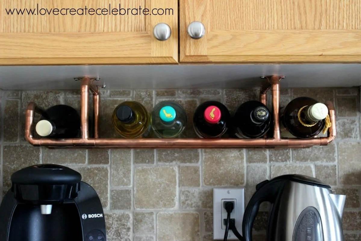 Wine bottles on an installed copper wine rack