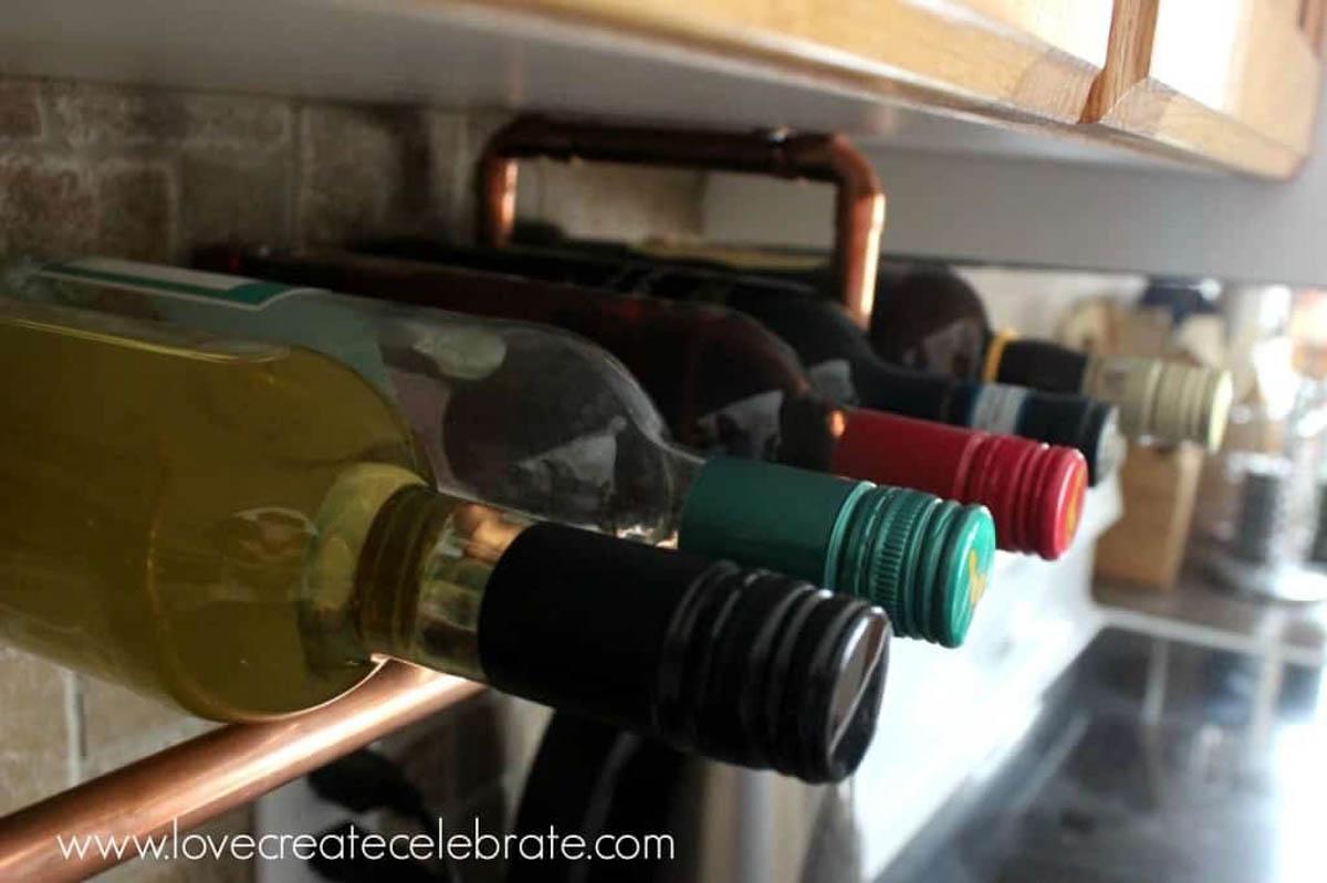 Wine bottles on copper wine rack